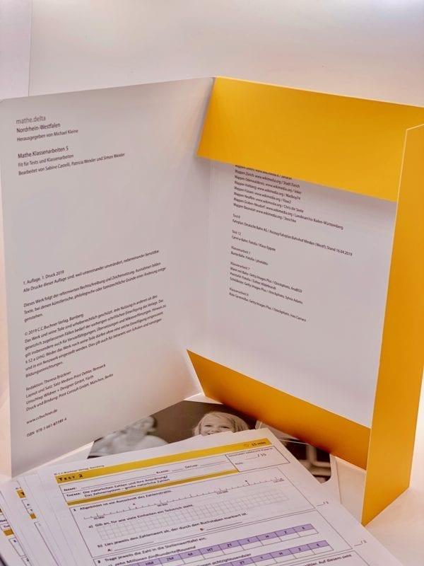 Folder: Loose-leaf collection, stapled brochure