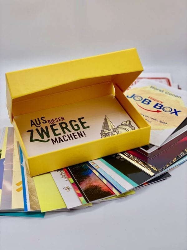 Hinged box: Postcards, booklet